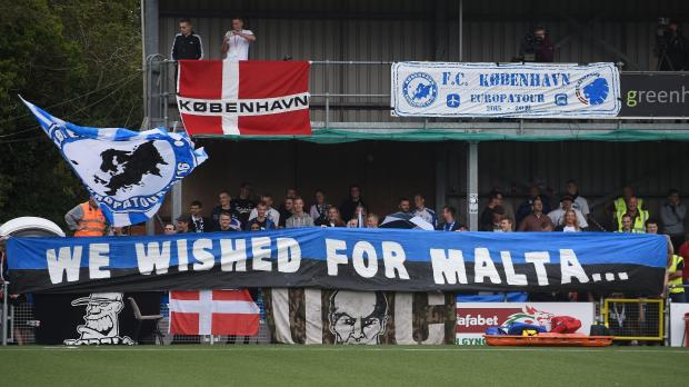 FC Copenhagen fans with a banner in the stands during the UEFA Europa League Second Round Qualifying match at Latham Park, Newtown. Copenhagen won 3-1.