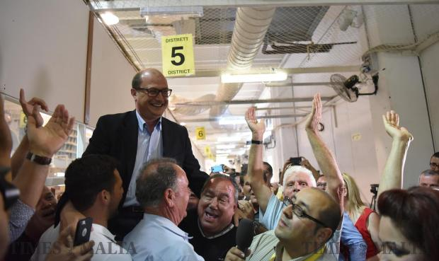 Newly elected Labour candidate Stefan Zrinzo Azzopardi is lifted up by counting agents moments after he won the casual election in the 5th district at the Naxxar counting hall on June 20. Photo: Mark Zammit Cordina