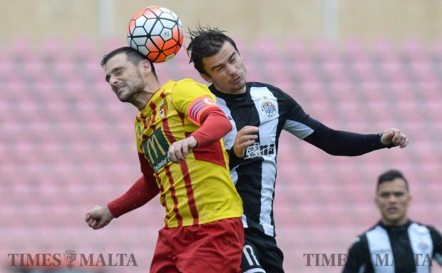 Birkirkara skipper Gareth Sciberras (left) in an aerial challenge with Bjorn Kristensen, of Hibernians at the National Stadium in Ta' Qali on January 29. Photo: Matthew Mirabelli