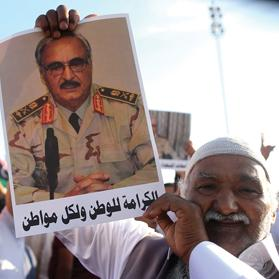 A man holds a picture of Khalifa Haftar during a demonstration in support of Operation Dignity in Benghazi last year.Photo: Esam Al-Fetori/Reuters
