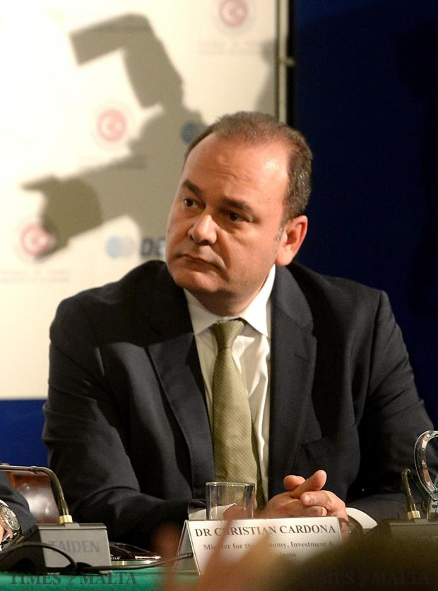 Economy Minister Chris Cardona attends a meeting of the Turkey-Malta business forum at the Chamber of Commerce in Valletta on February 17 as a silhouette of a camera lurks in the background. Photo: Matthew Mirabelli
