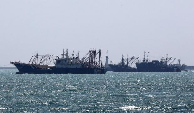 Ships sail in the Gulf off the Iranian port city of Bandar Abbas, which is the main base of the Islamic republic's navy and has a strategic position on the Strait of Hormuz.