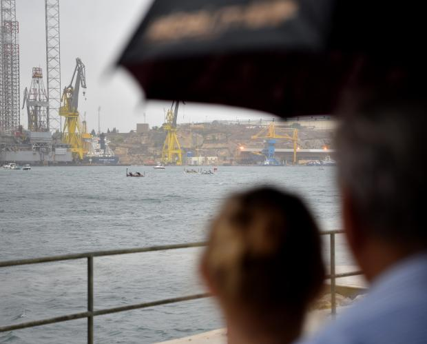 Two people watch the Victory day Regatta Races under an umbrella in heavy rainfall in Grand Harbour on September 08. Photo: Mark Zammit Cordina