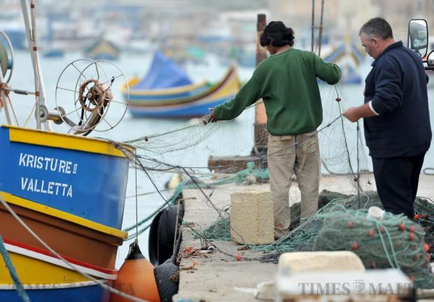 Fishermen sort out their nets at Marsaxlokk on February 17. Photo: Chris Sant Fournier