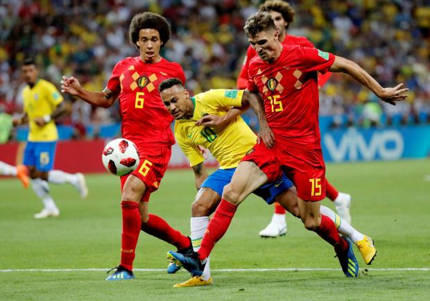 Thomas Meunier (right) challenges Brazil's Neymar during the World Cup quarter-final.