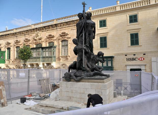 Workers putting the monument back in place this morning. Photo: Chris Sant Fournier