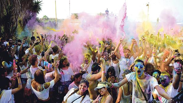 Holi enthusiasts, all in white, celebrated colour yesterday. Photos: Mark Zammit Cordina