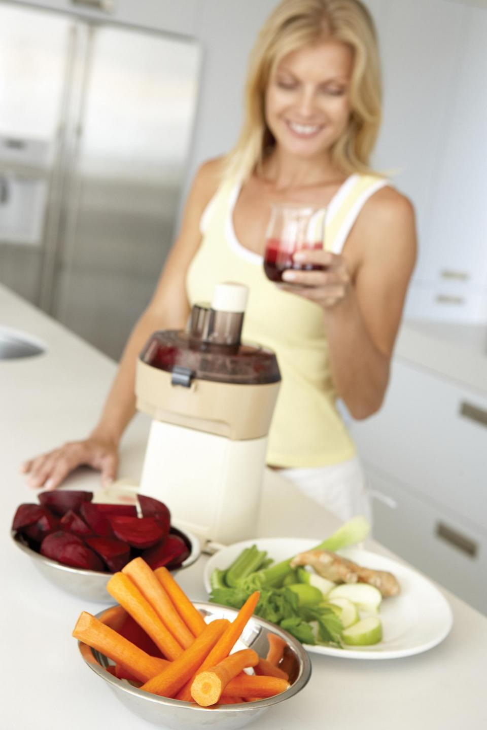 A woman drinking a fresh beetroot smoothie. Compounds found in beetroots can disrupt any cancerous mutation processes in cells. Photo: Shutterstock.com