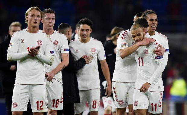 Denmark players applaud fans after the match.