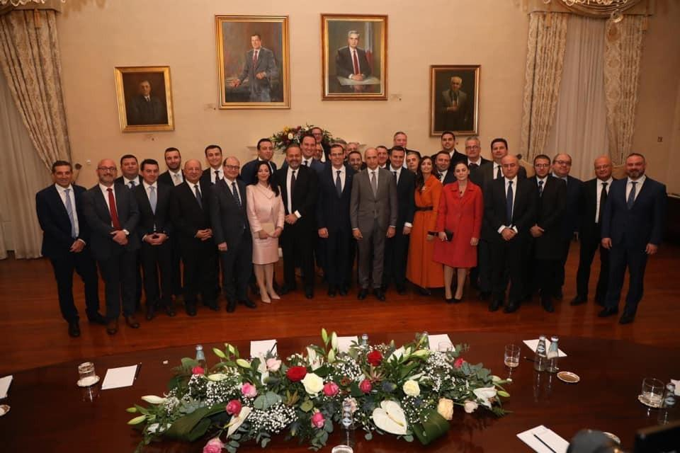 A bruised Chris Fearne poses alongside parliamentary and party colleagues in a group photo at Castille.