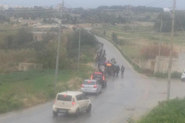 People marching to Bidnija on Saturday morning.
