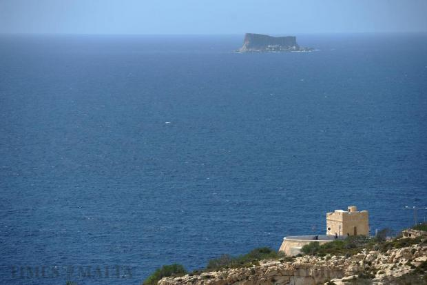 Tal-Ħamrija Coastal Tower is seen with Filfla in the background on September 20. Photo: Matthew Mirabelli