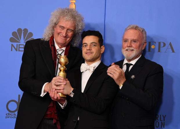5 nominations for Bohemian Rhapsody - Rami Malek poses with Queen band members Roger Taylor (R) and Brian May (L) during the 76th annual Golden Globe Awards.