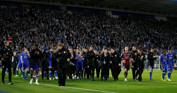 Leicester City players during a lap of honour in memory of Leicester City's late Chairman Vichai Srivaddhanaprabha after the match
