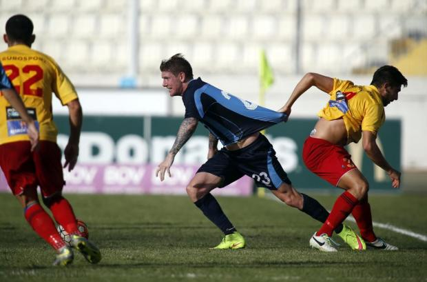 Birkirkara's Cain Attard (right) pulls the shirt of Sliema Wanderers' Gary Muir (centre) during their Premier League football match at the National Stadium in Ta' Qali on October 18. Photo: Darrin Zammit Lupi