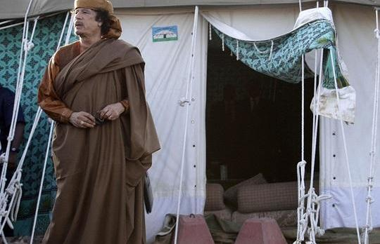 Col Gaddafi outside his tent in Tripoli yesterday.
