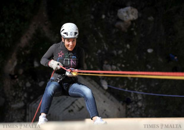 A woman abseils down Mosta bridge during the 34-hour abseiling marathon in aid of Id-Dar tal-Provindenza on November 21. Photo: Chris Sant Fournier