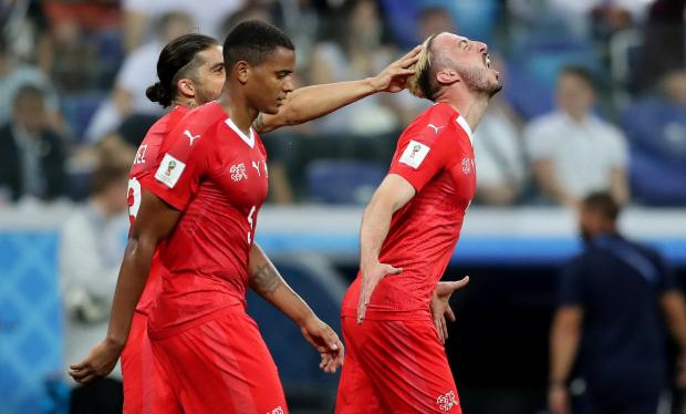 Switzerland's Josip Drmic celebrates scoring their second goal with team mates.