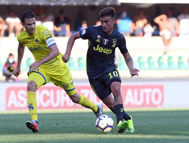 Paulo Dybala (right) charges forward for Juventus against Chievo.