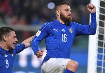 Italy beat Albania in match marred by crowd trouble