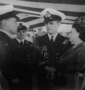 Chief Petty Officer Arthur Frederick Harvey (left) exchanging words with the royal couple on HMS Chequers in 1949.