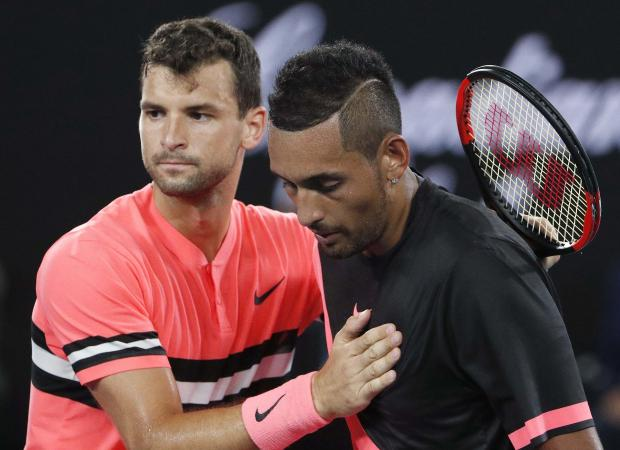 Grigor Dimitrov of Bulgaria chats with Nick Kyrgios of Australia after Dimitrov won their match.