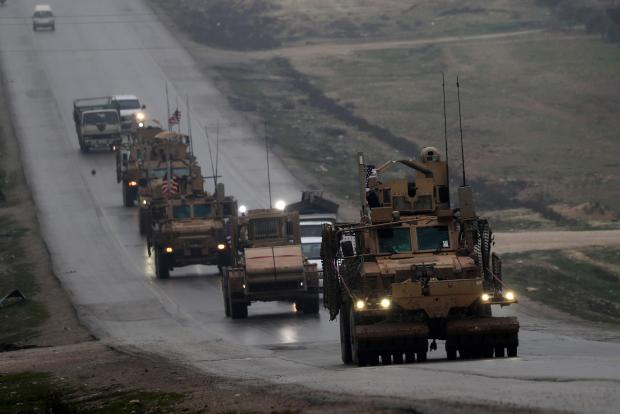 A convoy of US military vehicles rides in Syria's northern city of Manbij. File photo.
