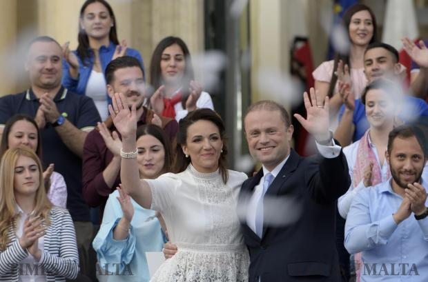 Prime Minister Joseph Muscat and his wife Michelle wave to the crowd gathered in Castille square during the 1st May mass meeting shortly after announcing an early election. Photo: Mark Zammit Cordina