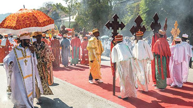 Orthodox priests attend the procession in the annual religious celebration of Timket.