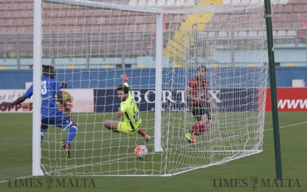 Hamrun Spartans forward Massimiliano Giusti scores a goal against Mosta FC at a game held at the National Stadium in Ta Qali on April 17. Photo: Mark Zammit Cordina