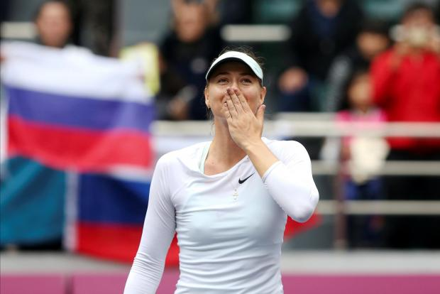 Maria Sharapova of Russia celebrates after winning the match against Aryna Sabalenka of Belarus.