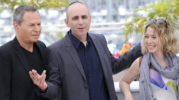 Israeli director Joseph Cedar (centre) with Israeli actors Shlomo Bar Aba and Alma Zak during the photocall of Hearat Skhulayim (Footnote) presented in competition at the 64th Cannes Film Festival on Sunday. Photo: Anne-Christine Poujoulat/AFP