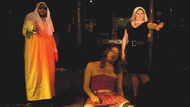 Teodor Reljic (centre) as the transvestite psycho-analyst with a penchant for women's underwear in an arousing session with his clients (Pete Farrugia and Bettina Borg Cardona). Photo: Stephen Buhagiar.