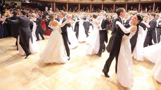 Young couples dancing at the traditional opera ball in Vienna.