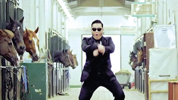 South Korean rapper Park Jae-Sang, aka Psy, doing the horse-riding dance in the video for Gangnam Style.