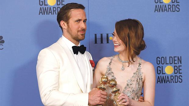 Ryan Gosling and Emma Stone at the Golden Globes where La La Land received a record seven awards.  Photo: Mario Anzuoni/Reuters