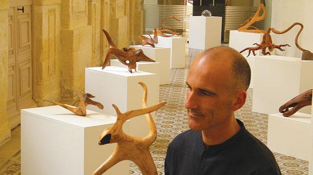 Loris Morosini with his wood sculptures.