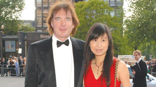 Julian Lloyd Webber and his fourth wife, fellow cellist Jiaxin Cheng, 35, who have become parents following the birth of their daughter, Jasmine Orienta. Photo: Ian West/PA Wire