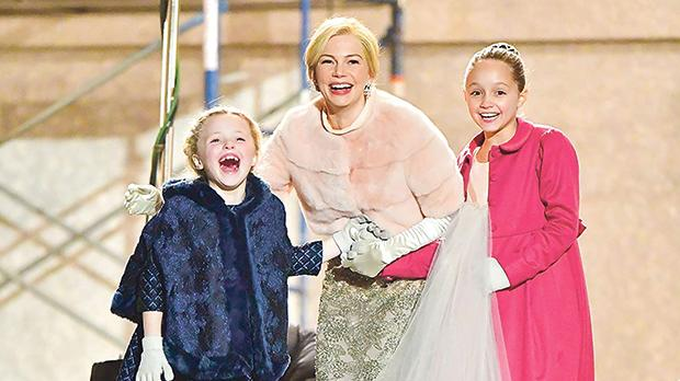Michelle Williams (centre) with Cameron Seely and Austyn Johnson in The Greatest Showman.