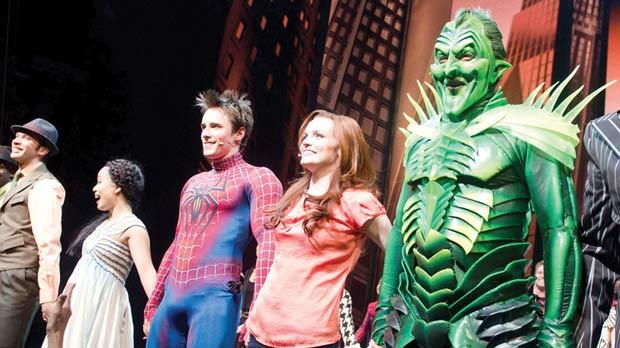 Patrick Page, right, Jennifer Damiano and Reeve Carney appearing on stage at the curtain call for the opening night performance of the Broadway musical Spider-Man: Turn Off the Dark in New York, on Tuesday. Photo: Charles Sykes/AP