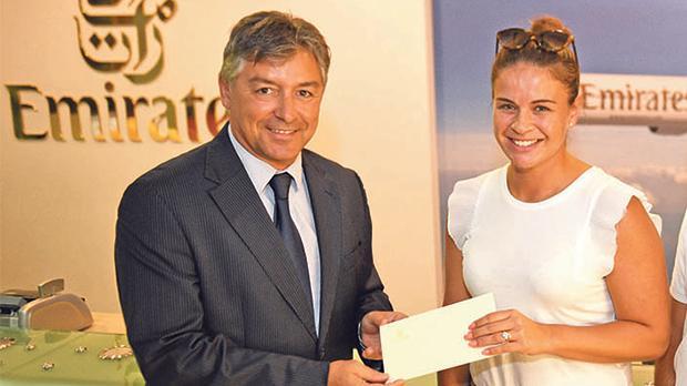 Emirates Malta manager Paul Fleri Soler presenting the gift vouchers to Alexandra Vella.