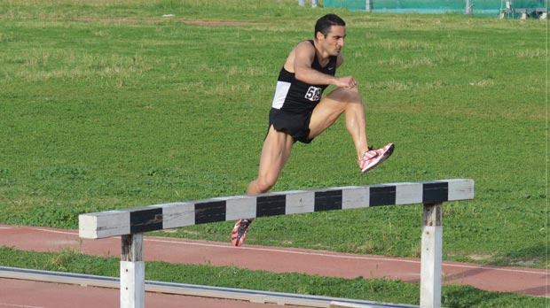 Mark Herrera clears a hurdle during a 3,000m steeplechase race at the Marsa Athletics Stadium.