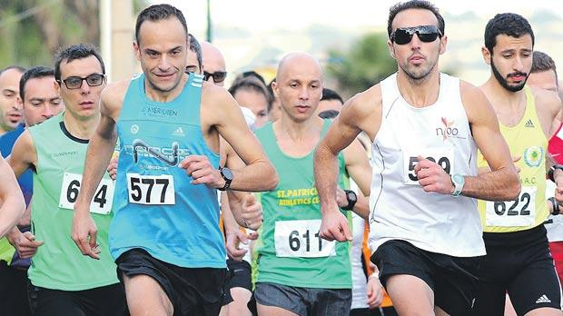 Charlton Debono (right) and Andrew Grech (no.577) lead the group in Qawra. Photo: Wally Galea