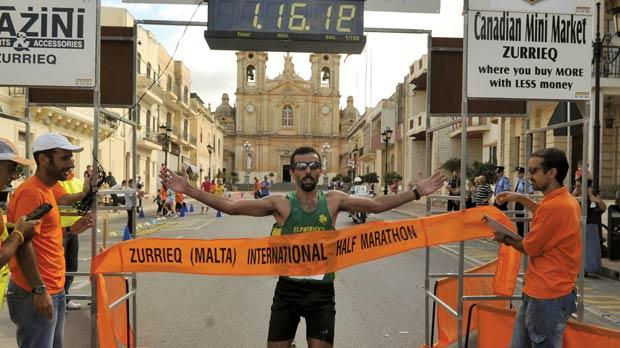 Jonathan Balzan crosses the finish line to win the Żurrieq half marathon.