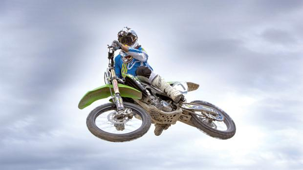 A Motocross rider flies into the air during last weekend's races. Photo: Mario Micallef