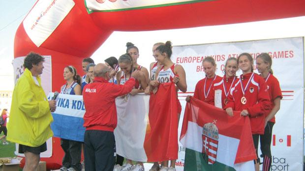 The Maltese girls quartet on the highest step of the podium in Brno.