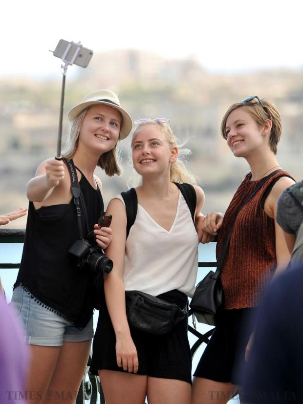 Tourists take a selfie at the Upper Barrakka Garden in Valletta on September 21. Photo: Chris Sant Fournier