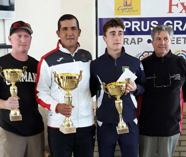 William Chetcuti (second left) holds his trophy in Cyprus.