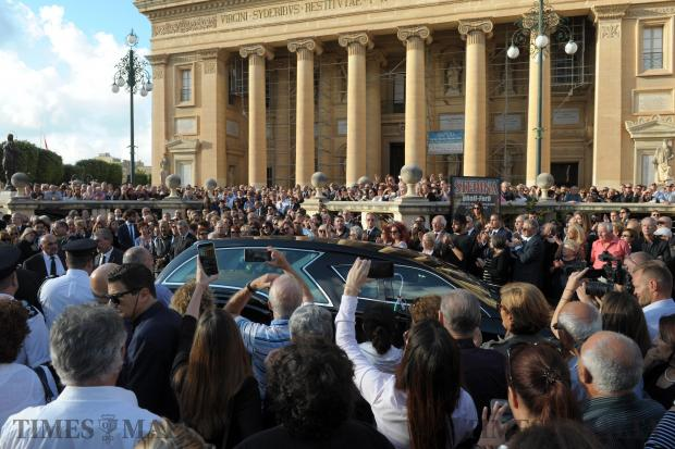 People gather outside the church in Mosta for the funeral ceremony of murdered blogger Daphne Caruana Galizia, on November 3. Photo: Matthew Mirabelli