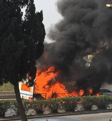 The caravan was quickly engulfed in flames.